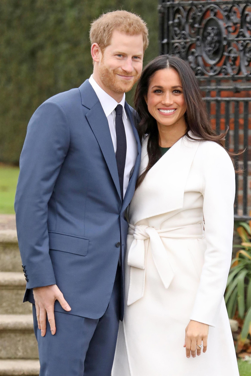 Meghan-Markle-wore-a-Line-The-Label-belted-white-coat-to-her-engagement-photocall-with-Prince-Harry